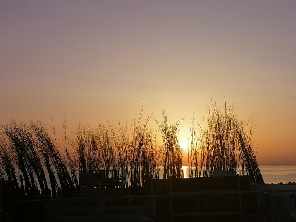 zonsondergang, Brouwersdam, zomervakantie in Nederland met pubers